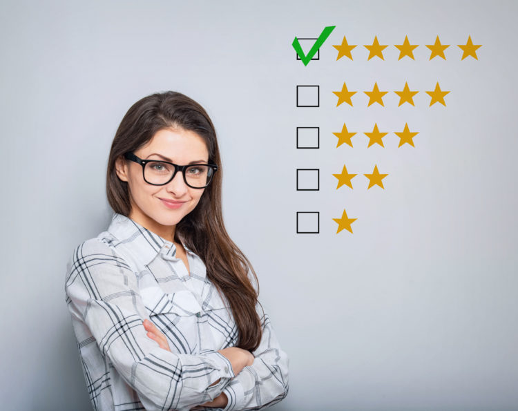 young woman standing beside review rating stars display
