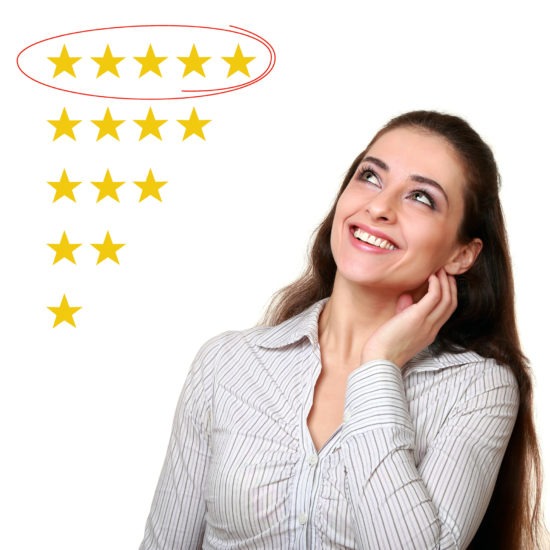 young woman looking at review stars